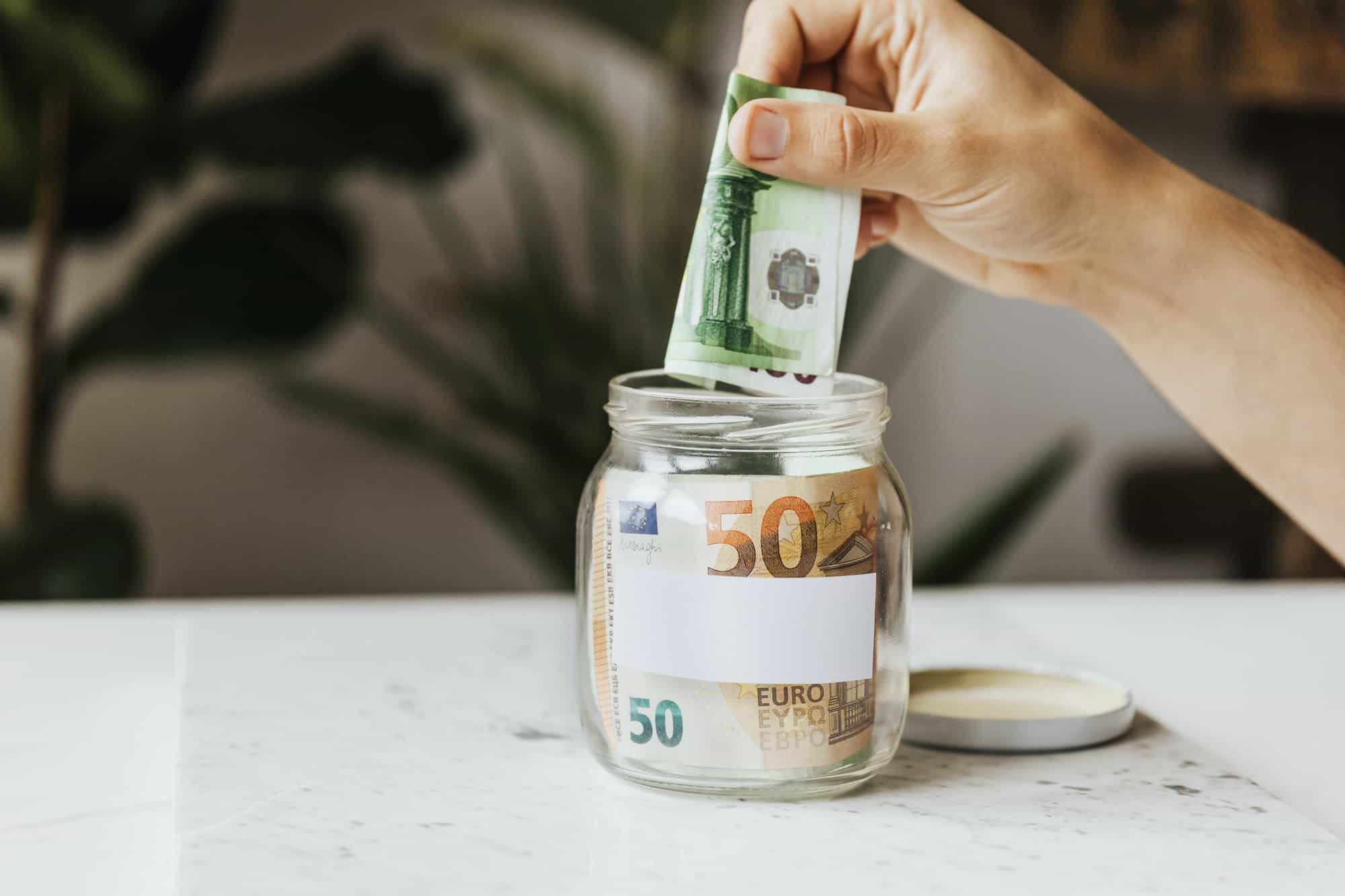 Saving money in a jar during the COVID-19 pandemic